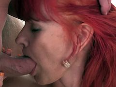 Redhead granny with short hair getting her juicy pussy being smashed hardcore doggystyle before moaning while being licked