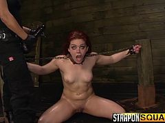 This unlucky slave girl is chained up and locked in stocks by her dommes. She gets a hitachi vibrator used on her wet pussy and a big black strap on, down her throat. The two mistress really love to make their slave feel uncomfortable, and take humiliating pain, and pleasure.