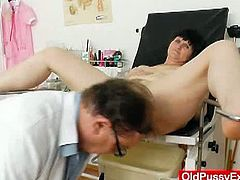 After looking inside Slavomira's cunt with a speculum and stretching it with a vibrator, this perverted gynecologist also gives her an enema. She seems to like it.
