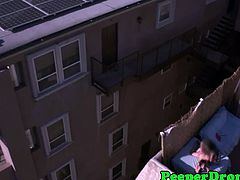 Amazing aerial shot from a flying camera as it films these horny couple who are naked and caught fucking in the balcony. Watch the action in an awesome aerial style shots.