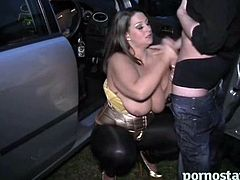 Danni Sweet gives a hot blowjob and tit fuck to this lucky guy in the parking lot.