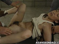 Tender Japanese gal is being held down by a raunchy army officer while other horny dudes take turns in filling her wet hairy pussy with throbbing cocks.