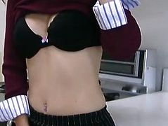 Sexy brunette stripping and toying her pussy in the kitchen