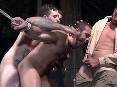 Muscular stud goes hardcore BDSM and he let his arms tied up and forced him to suck hard cocks and got his butthole fucked while he got a nasty whip to deal with.
