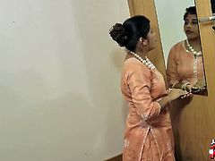 Chubby indian teen toying in standing position