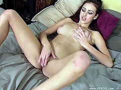 Amazing solo model brunette with long hair displays her natural tits before masturbating passionately using huge sex toy