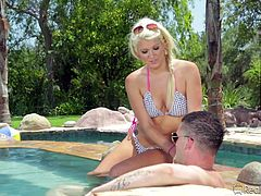 This sexy blonde chick was having a nice swim, when she had a sudden craving for cock. Her man was sitting on the deck and he was happy, to get a blowjob. The couple heads inside, for some more sexy action.