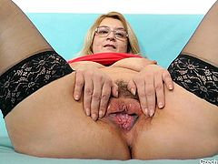 This ugly mature slut opens up her hairy pussy for you, so you can see deep inside her snatch. She grabs and shows off her saggy tits for you, as well. She is such a dirty old lady. Look at how nasty she is.