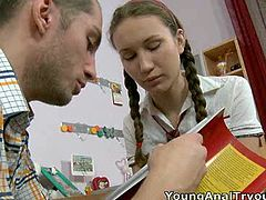 Naughty fair haired teen with pigtails gives a head to her young teacher