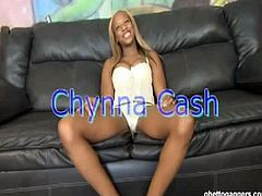 Ghetto Gaggers Chynna Cash is truly a ball sucker. Chynna Cash is holding the penis while her mouth is sucking the balls of a white guy. Chynna Cash is on her knees while sucking away. Her hair is dyed with hydrogen peroxide. There is a little bit of black underneath the dyed hair. Her eyes are dropping while sucking the ball. Chynna Cas is looking sleepy. Her fingernails are long and they are painted on its tip. Chynna Cash is kneeling down on a white carpet. There is a black leather couch beside this ball sucking woman.