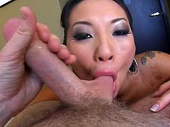 This lovely Asian sluttie likes to take a huge cock in her mouth for a suck in a hardcore blowjob and receives a facial cumshot load.