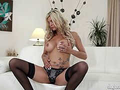 This sexy blonde is such an alluring site to behold. She looks super sexy in her lingerie and she spreads her legs wide, to reveal such an amazing snatch. Before long she is dripping wet and furiously flicking her clit. What a sexy mama!