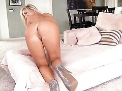 Tasha Reign with giant melons and bald snatch strips and plays with her wet hole