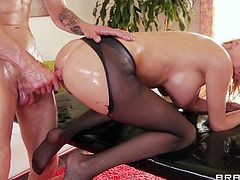 Blazing pornstar in a nylon pantyhose aroused as her hot ass gets oiled and massaged then gives a blowjob before getting drilled doggystyle