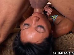 Attractive Asian chick sucks on a fat dong and gets mouth fucked hard. She receives that hard dick in her shaved pussy and her delicate little anus.