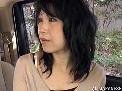 Arousing Japanese milf giving a spicy blowjob in the car