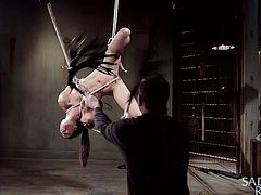 This dirty slut is tightly tied up in rope and hanged from the ceiling in the dungeon. The master has her right where he wants her. The slave's legs are spread open really wide, and the sex toy is inserted into that pussy nice and deep.