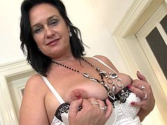 This dark haired mature slut loves to show off her natural breasts. She leans in and shows off her natural boobs. When she juggles her tits, it's quite a sight. Wouldn't you love to see your cock in between her floppy breasts?