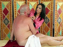 Everyone loves Tia's massage, because she gives great rubdowns. She is also very skilled at giving happy endings. She tugs this old guy off and makes him spurt. She even uses her mouth and gets his cock wet with a blowjob.