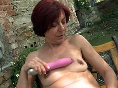 She is out in the backyard, enjoying the sun and getting a nice tan all over her wrinkled skin. The mature slut decides to take out her favorite sex toy and masturbate right then, and there. The hot slut rubs the sexy toy all over her pussy and nipples.