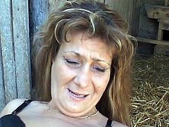 Check out this hot slutty mature babe as she fucks this nice barn yard farmer in this porn video.