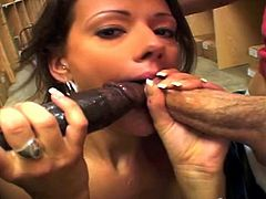 An interracial double penetration with a white and black dick