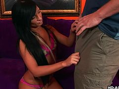 Petite brunette leans over to suck his fabulous dick and she likes it so much that she almost chokes on it, while this horny bastard fingers her delicious pussy.