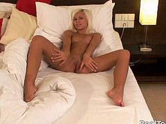 Nasty blonde Lucy enjoys rubbing her clit before going to bed