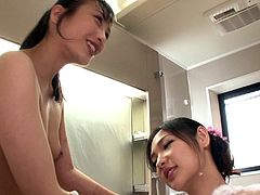 Japanese lesbians with natural tits have fun in a soapy bath session