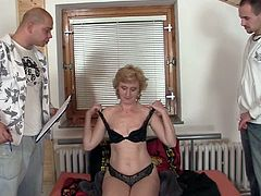 This old lady orders something and when the two horny delivery man was right into her bedroom, she removes her clothes indicating to let them fuck her old pussy.