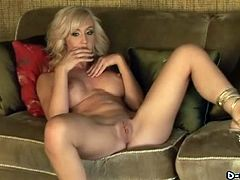 Blonde porn star with big fake tits enjoying a hardcore vibrator fuck