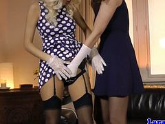 Brunette babe Lara and one young, hot blonde put on sexy lingerie and start kissing. They taste each others pussies and they also hug like they were scissoring.