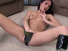 Amaera is a sexy redhead giving you a solo scene that'll make you pop an instant boner. Watch this babe taking off her bikini and fingering her pink shaved pussy.
