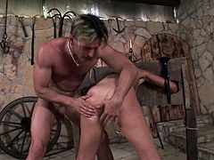 Debbie White plays slave as she is spanked,tortured and screwed in a BDSM scene