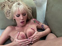 Tattooed blonde babe with big natural tits gives a tit job after getting her pussy pounded hardcore