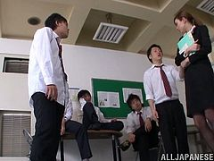 Cheerful Japanese redhead gets a facial cumshot after getting gang banged hardcore in the office