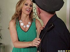Elegant well-endowed MILF Julia Ann in green dress gets down on her knees in front of a lucky dude. She makes his fat dick disappear in her experienced mouth.This mature woman is good at cock sucking