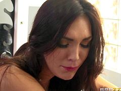 Pretty brunette Holly Michaels with huge natural tits and hairy snatch feels horny after work out. She gives deep blowjob and gets her fuck hole stuffed by Keiran Lee at the gym. She loves his fat cock.