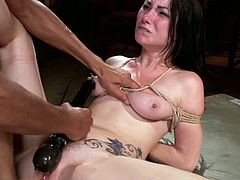 Dungeon Sex brings you very intense free porn video where you can see how this tattooed brunette slut gets bound and assfucked into a massively intense orgasm.