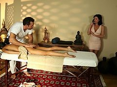 A male massage therapist rubs then fucks two babes
