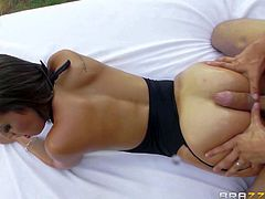 Kelsi Monroe is a dangerously sexy brunette with perfect ass. She gets her tight asshole fingered and her pussy dicked from behind under the open sky. This round ass doll is so fucking horny!