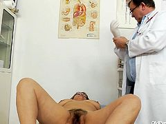 Dr. Feelgood is very thorough! He checks Lydia's vital signs, palpates her abdomen and then, pulls her panties down for the good part! Lydia spreads her legs, showing off her hairy pussy! Dr. Feelgood warms his hands up, and begins the examination.