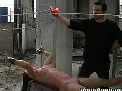 This slave must endure hours of torture, as she is tied up and hanged upside down in a crumbling warehouse, with cement everywhere. Her cruel master drips burning hot wax all over her stomach and breasts.