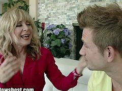 Horny blonde milf Nina Hartley is so happy to see her boyfriend's son all grown up and she is begging him to fuck her pussy