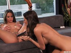 Pleasing lesbian with fake tits getting her pussy licked immensely before enjoying the pleasure of massive sex toys indoors