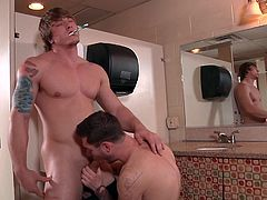 Vance Crawford makes the first move at the college bathroom and Tom Faulk can't say no! After some oral action, Tom jumps up and shows Vance his tight hole. He gladly replies, by grabbing his hard cock and eating it.