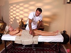 She sucks his cock while he gives her an oily massage
