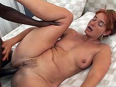 This naughty slut wraps her lips around this gigantic black cock. She slurps all over the big black penis and then, she gets her old pussy pounded hard by her lover. He shoves his big cock into her pussy hard.