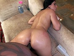 Oiled up brunette slut gets her pussy black cock fucked after BJ