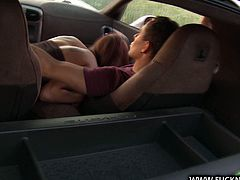 Leggy red haired babe in sexy mini skirt gives blowjob to strange dude in the car